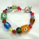"Glass Bead Evil Eye multicolored bracelet 6""  silver tone toggle catch"
