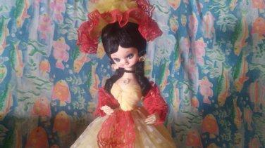 display doll yellow