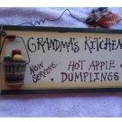 """HANGING PLAQUE.""""Grandma's Kitchen Hot Apple Dumpling"""" WOOD WITH WIRE HANGAR.."""