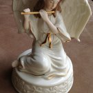 "7"" Angel figurine, with music box, gold trim, holding flute"