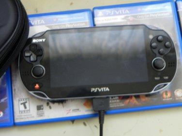 Black Sony PS Vita 8gb (Wi-Fi) w/ 5 games