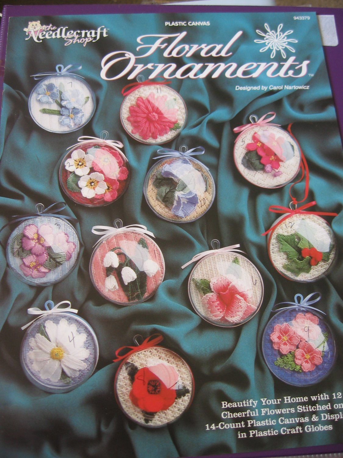 Floral Ornaments in Plastic Canvas Displayed in Plastic Craft Globes