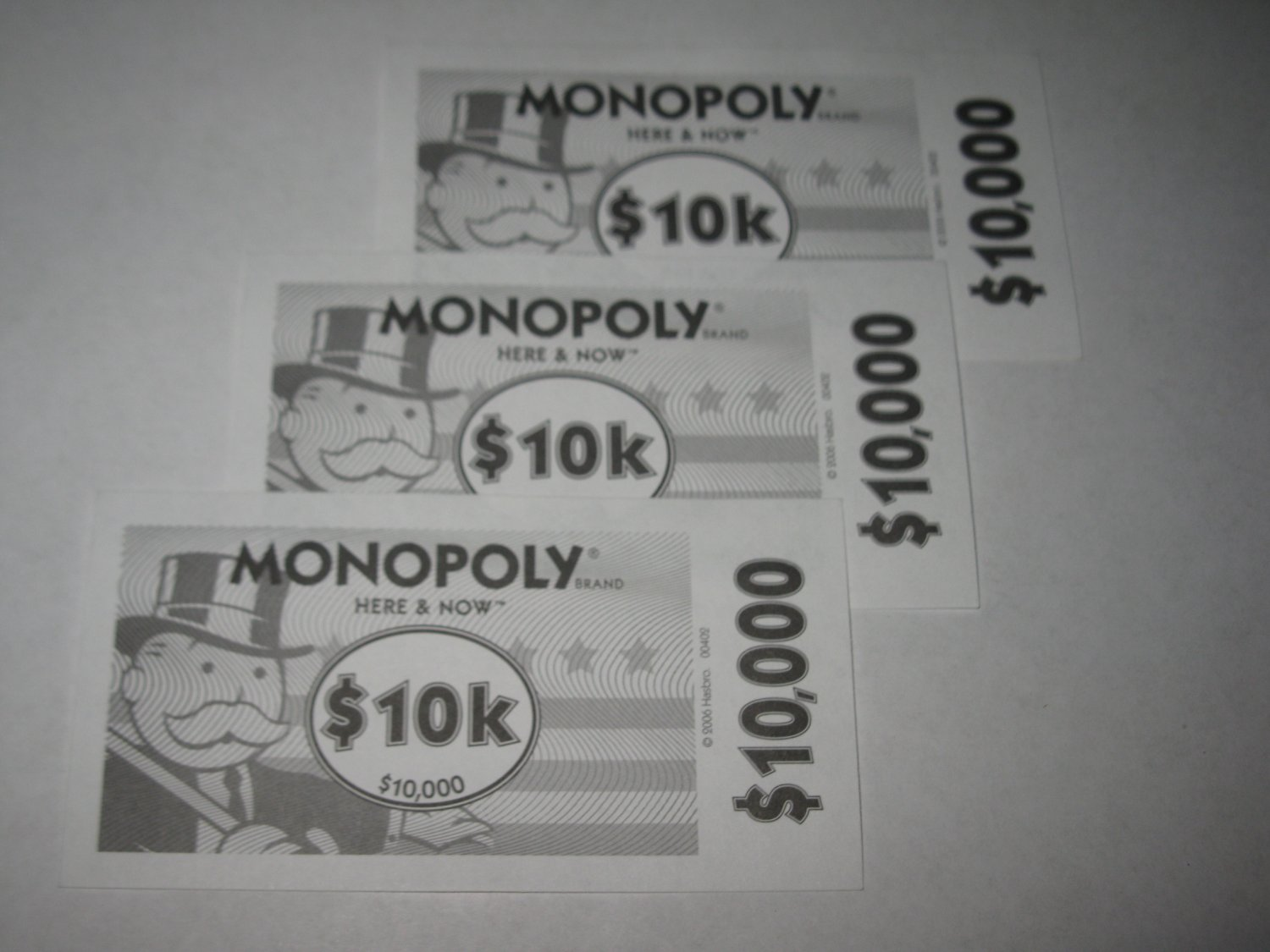 2006 Monopoly - Here & Now Board Game Piece: stack of money- (3) $10,000 Bills