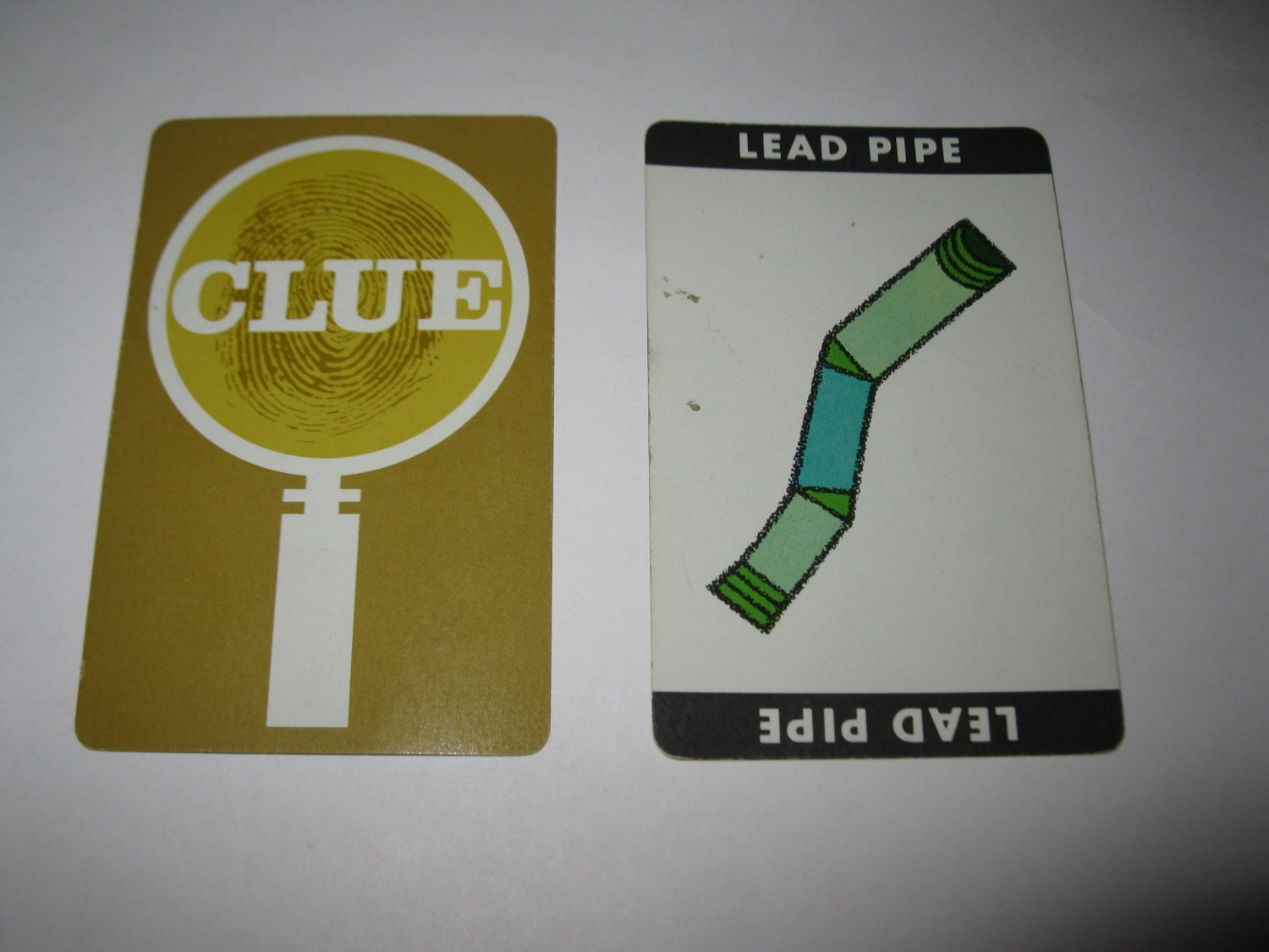 1963 Clue Board Game Piece: Lead Pipe Weapon Card