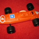 vintage 1960's Balloon Propelled Red Racecar - w/ stickers, Volvo - Elephant Emblem on bottom