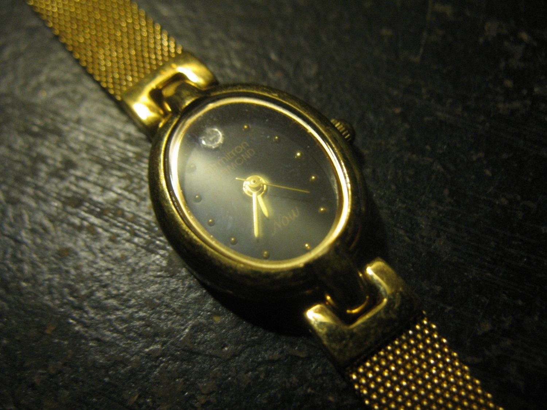 Armitron Watch: Diamond NOW gold w/ Black Dial, gold Mesh Band Quartz
