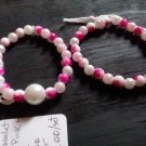 2 pink and white marble bracelets