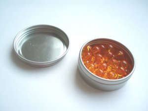 45 Golden Bead Units in a tin container