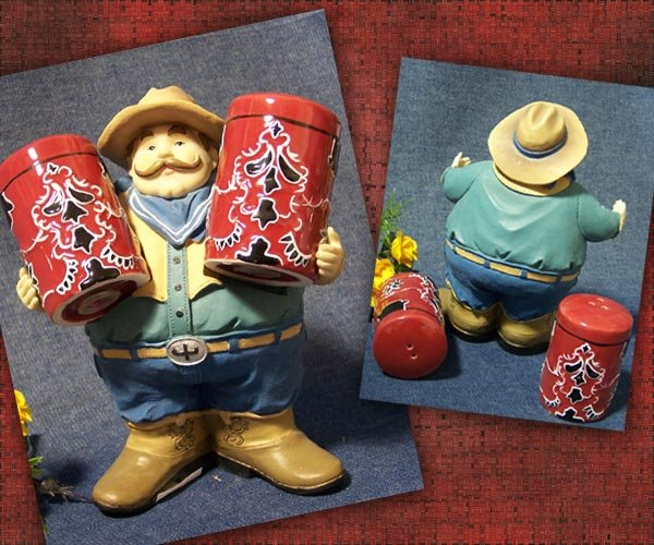 Large Cowboy holding Salt & Pepper Shakers
