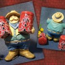 Large Cowboy holding Salt & Pepper Shakers