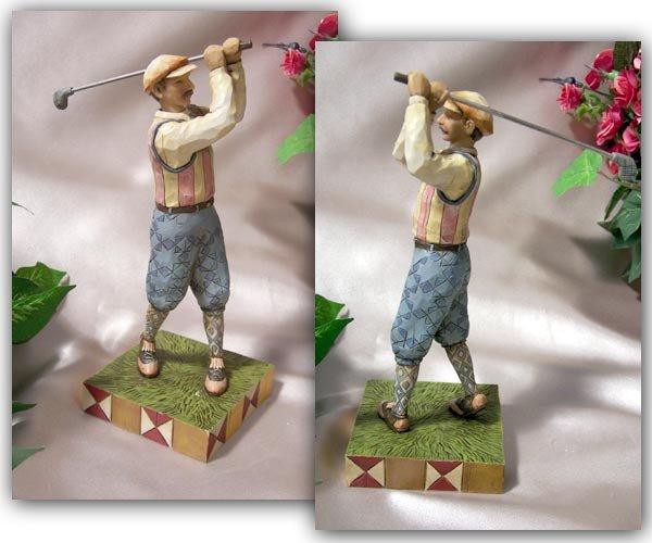 Jim Shore Golfer Swinging
