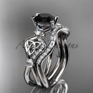 14kt white gold celtic trinity knot engagement set with a Black Diamond center stone CT768S