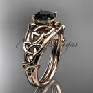 14kt rose gold celtic trinity knot engagement ring with a Black Diamond center stone CT765