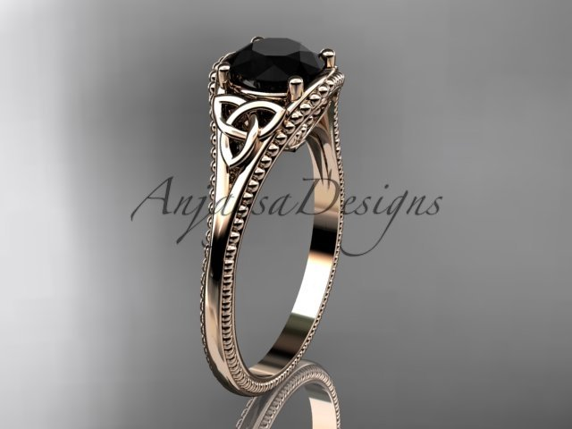 14kt rose gold celtic trinity knot engagement ring with a Black Diamond center stone CT7375