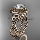 14kt rose gold celtic trinity twisted rope wedding ring with a  Moissanite center stone RPCT9320