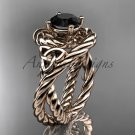 14kt rose gold celtic trinity twisted rope wedding ring with a Black Diamond center stone RPCT9320
