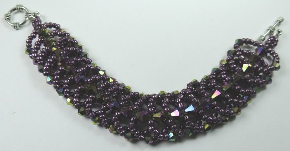 handcrafted Purple Crystal and Seed Bead Bracelet