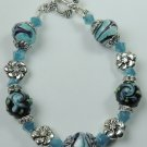 handcrafted Turquoise and Black Floral Lampwork Bracelet