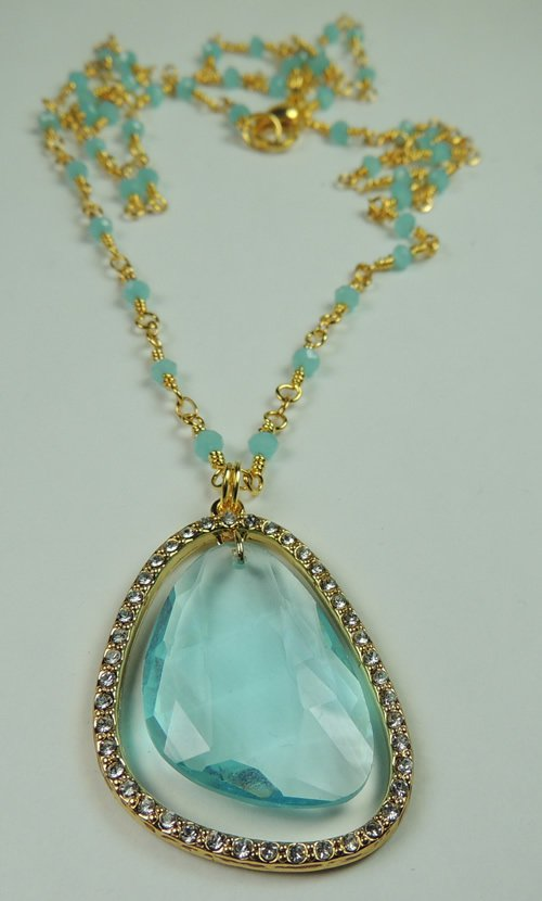 NEW WOMANS TURQUOISE CRYSTAL FRAMED BY RHINESTONES ON GOLD TONE CHAIN WITH TURQUOISE CRYSTALS