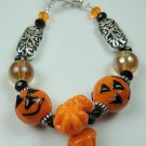 ORANGE AND BLACK JACK O LANTERN & PUMPKIN LAMPWORK BRACELET
