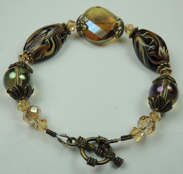 Black Brown & Beige Swirl Lampwork Bracelet Accented with Brass Tone Metal