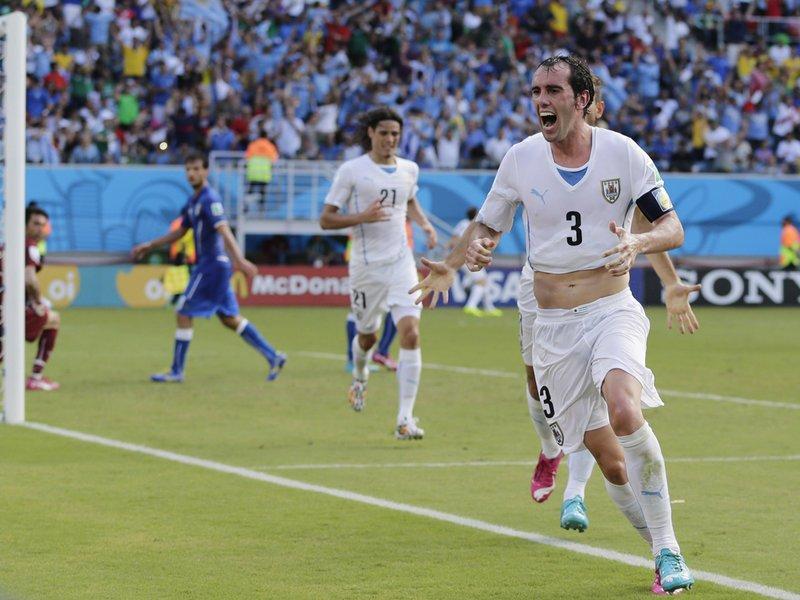 057 -  8 X 6 Photo - Football - FIFA World Cup 2014 - Italy V Uruguay Diego Godin Celebrates