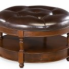 ELEGANT NOTTINGHAM TUFTED LEATHER OTTOMAN W/1 SHELF,32''DIAM X 19''TALL.