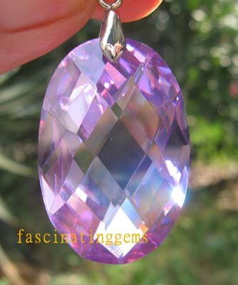 IF~50.00CT CHARMAING OVAL PURPLE ZIRCON PEADANT