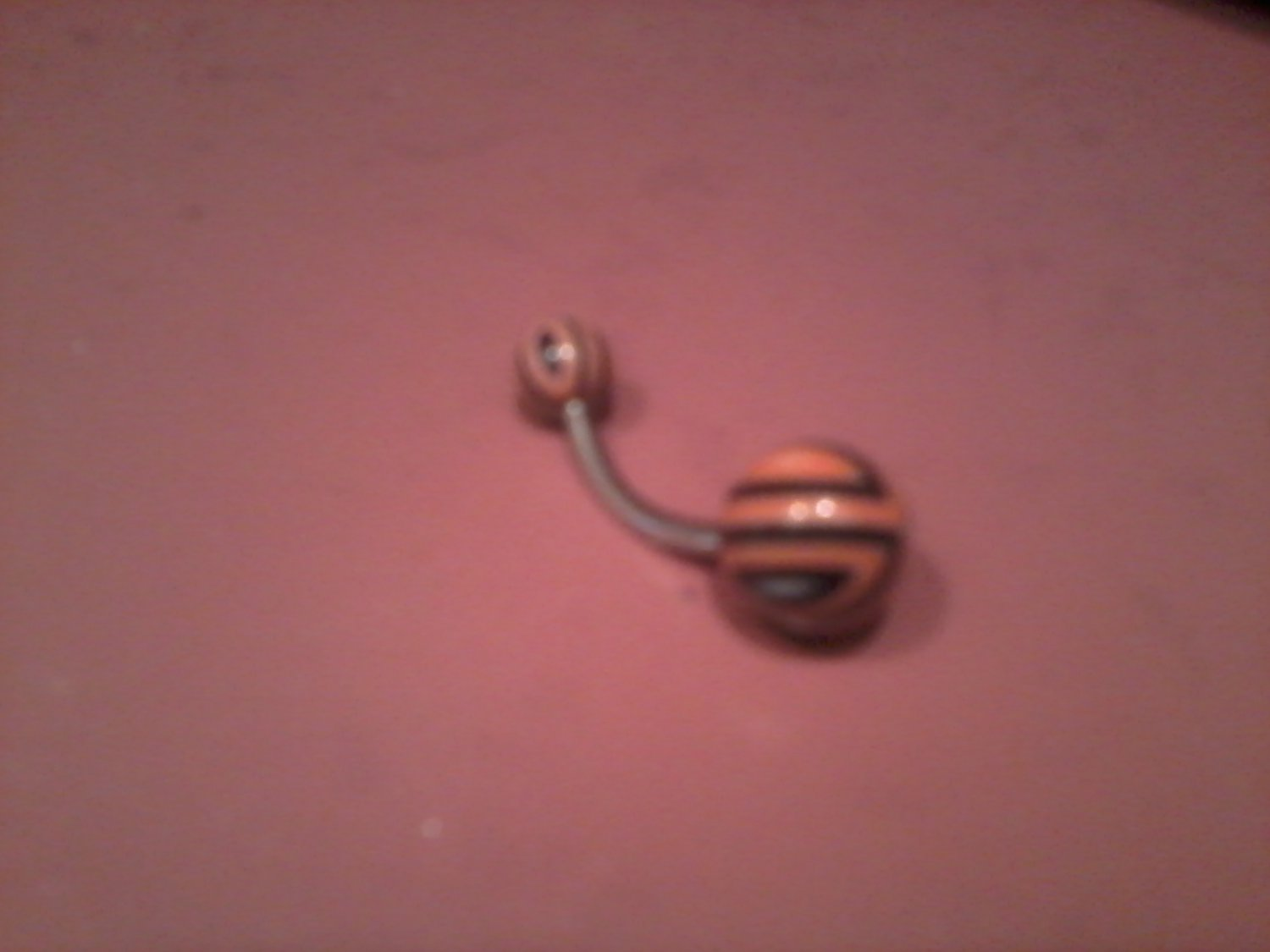 orange black and white belly button ring