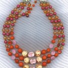 VTG. ART GLASS IN REDS & ROSE 3 STRAND BEAD NECKLACE