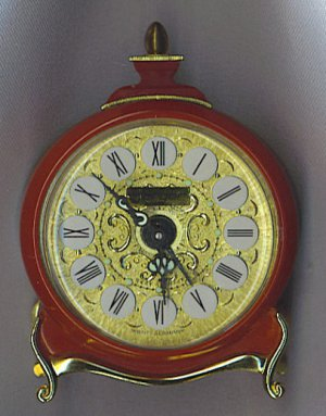 JERGER GERMANY SMALL CLOCK IN RED & GOLD