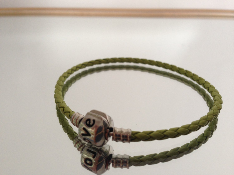 Braided Bracelet With Charm Closure