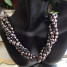 Multi hued 4 string twisted pearl choker with 14k clasp