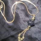 vintage gold necklace with black and gold pendant