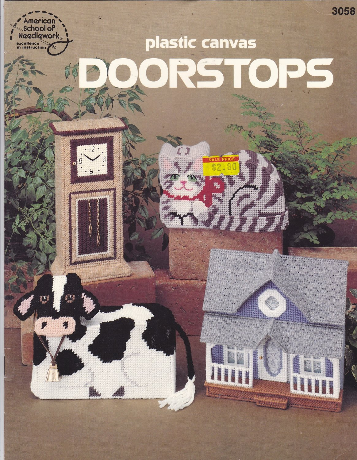 Plastic Canvas Doorstops pattern booklet 3058 Cow Cat House Grandfather Clock Barn Hotel