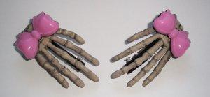 Pink Bow Skeleton Hand Barrettes