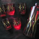 Red glass decanter and 5 glasses with gold pattern