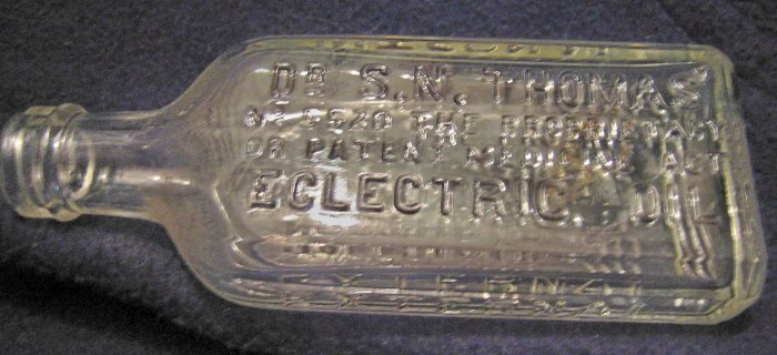 Dr. S N Thomas Eclectric Oil Glass Bottle by Northrop & Lyman Co. Ltd.