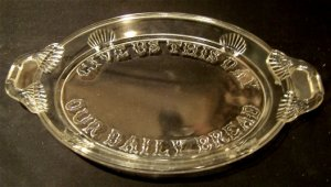 "Antique clear glass handled tray with ""Give Us This Day Our Daily Bread"""