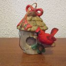 Cardinal perched on a birdhouse Christmas Ornament