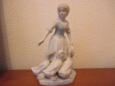 Vintage Porcelain Woman with ducks figurine