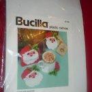 1993 Bucilla Plastic Canvas 61169 SANTA FACE COASTERS Set of 6 plus Holder  NIP