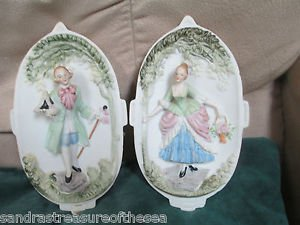 Hand Painted Porcelain Bisque Occupied Japan Colonial Man and Woman Wall Plaques