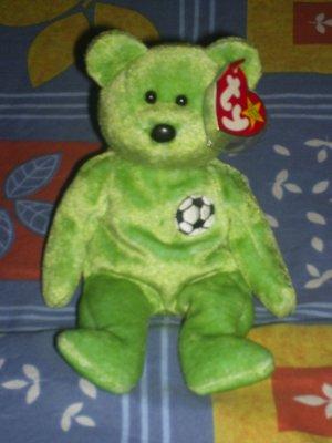 kicks the soccer bear
