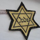 WWII THE GERMAN BADGE  stripe. Yellow Star of David with the word JUDE