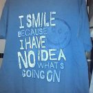 "T SHIRT L/XL ""NOVELTY"" SHIRT BLUE/GRAY SMILE FACE & SAYING ""SMILE HAVE NO IDEA"""