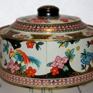 Round tin with parrot type birds and a funky design with flowers unknown maker