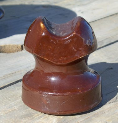 Unmarked brown ceramic insulator used