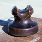 B in a circle brown colored ceramic insulator used
