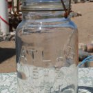 Clear Atlas E-Z Seal quart size canning fruit jar wire type closure used empty